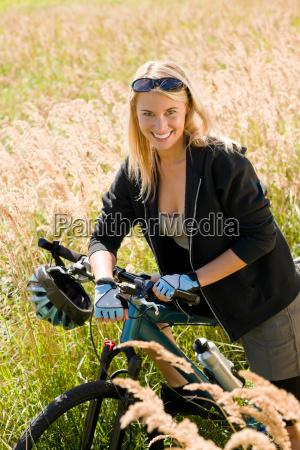 mountain biking young woman sportive sunny