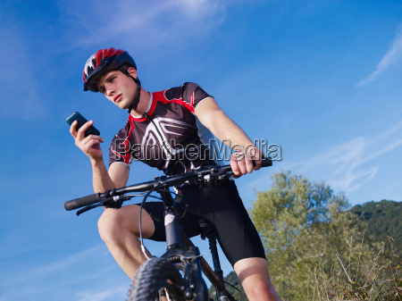 young man with telephone riding mountain