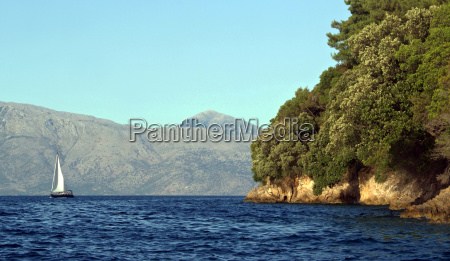 sailboat before onassis island scorpios