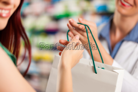 pharmacist in her pharmacy with a