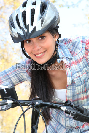 young woman riding bike in the