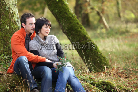 couple sitting in woods