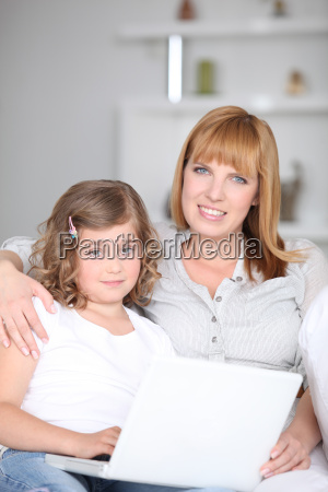 woman helping her daughter with her