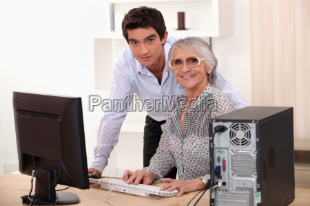 young man and older woman using