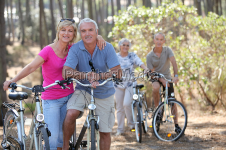 two elderly couples on bike ride