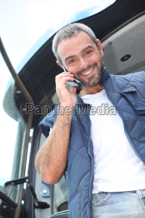 farmer standing in the cab of