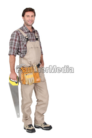 builder with saw