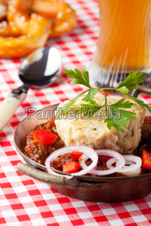 goulash with dumpling on a wooden
