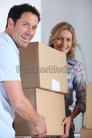 couple moving a pile of large