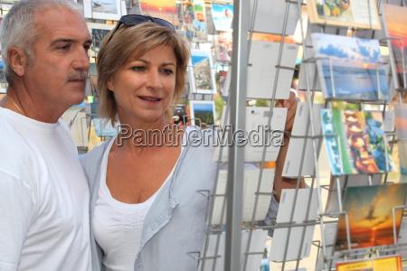 senior couple on vacation shopping