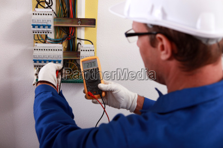 an electrician checking the energy meter