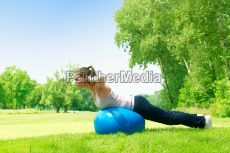 fitness women exercising with pilates ball