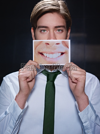 businessman with big mouth smiling at