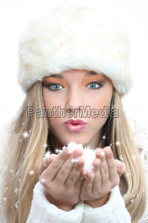 beautiful girl blowing christmas or new