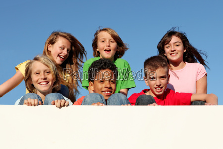 group of diverse kids holding blank