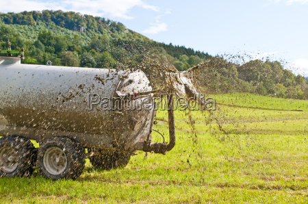 tractor moves manure