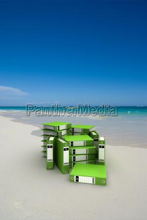 green folders on the beach