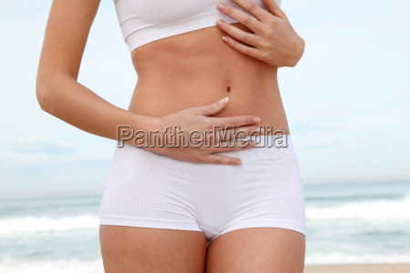 closeup of womans body stretching on