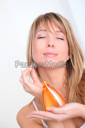 portrait of beautiful woman holding scented