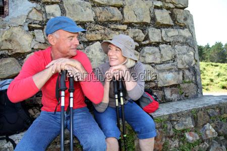 portrait of happy senior hikers resting