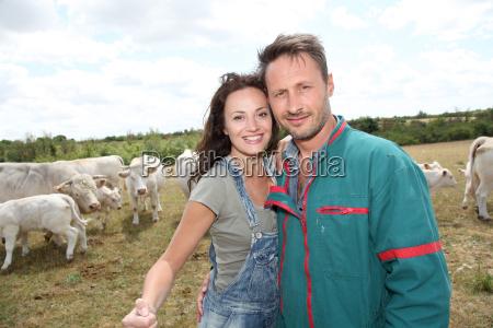portrait of smiling breeders in farmland
