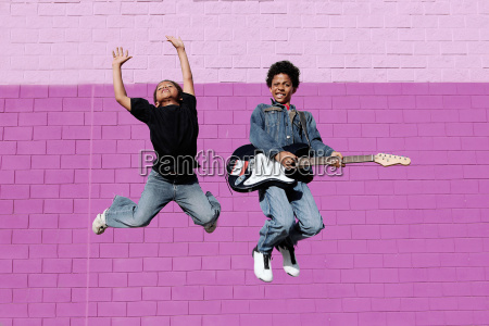 happy african descent kids playing music
