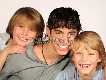 happy group of smiling brothers with
