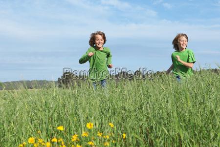 healthy fit kids running through field
