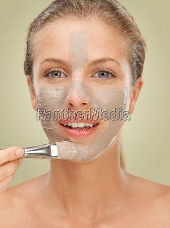 closeup beauty portrait woman applying facial