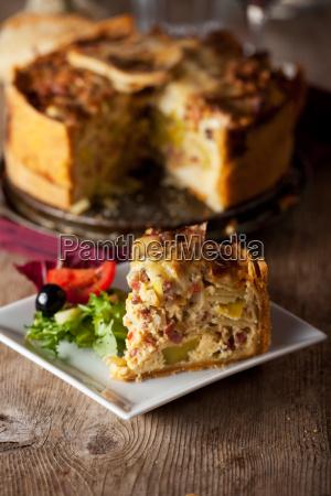 piece of quiche lorraine with salad