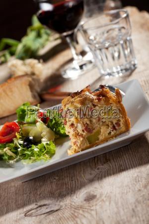 slice of quiche lorraine with salad