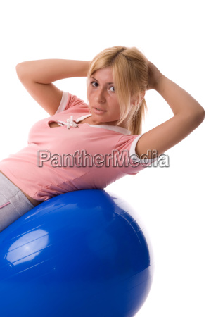 fitness woman practicing by ball