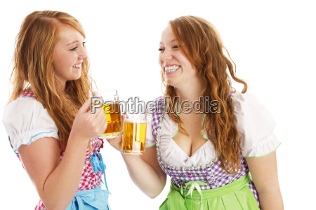two happy women in dirndl abut
