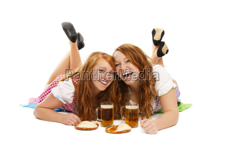 two happy women in dirndl with