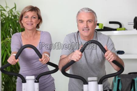 senior couple riding bikes in the