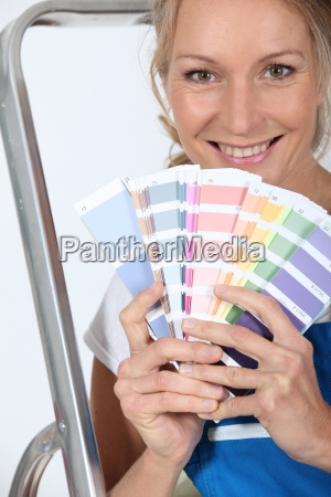 female decorator with a selection of