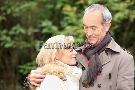 old couple wearing warm clothes in