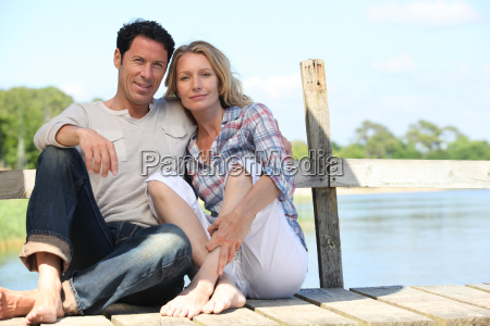 mid age couple seated on a