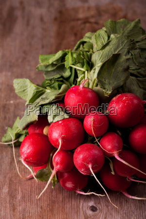 bunch of radishes on wood
