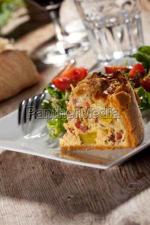 fresh quiche lorraine on a wooden
