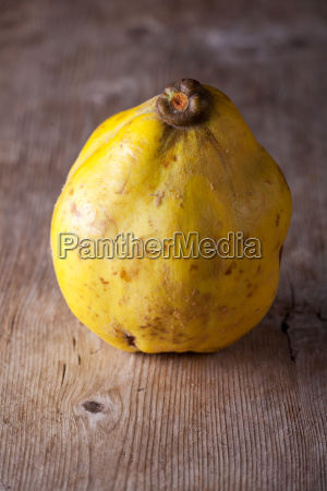 quince on a wooden board