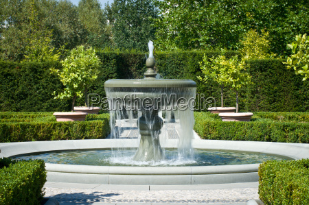 the fountain in the garden in