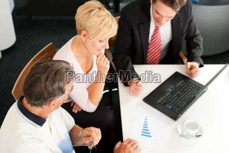 elderly couple at financial advisor