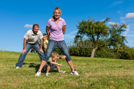 family with children is playing on