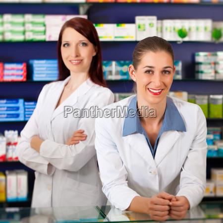 pharmacist team in pharmacy drugs