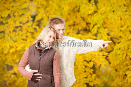 autumn romantic couple smiling together in