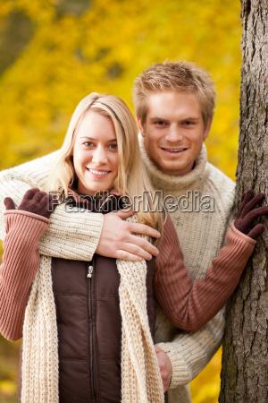 autumn love couple hugging happy in