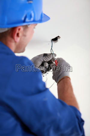 electrician fixing electrical wiring