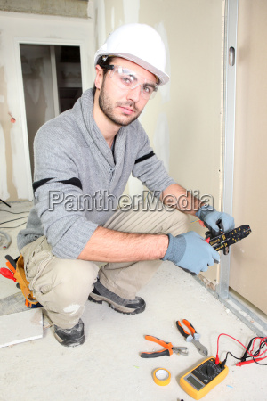 electrician wiring up new home