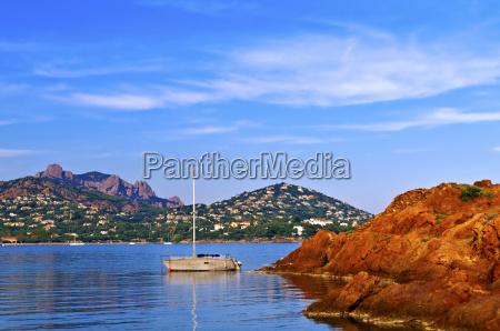 rocks yacht and sea
